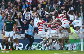 Japan's players celebrate what may, perhaps, become the most famous try in rugby history.