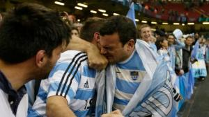 Argentina's captain Agustin Creevy celebrates with a fan after last weekend's thrilling victory over Ireland in the Rugby World Cup quarter-final at a packed Millennium Stadium.