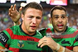Burgess and South Sydney Rabbitohs teammate, the already legendary Greg Inglis, celebrate 2014's Grand Final victory, the club's first in 43 years.
