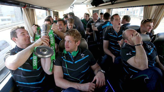Peter O'Mahony and Chris Henry pass the Trophy around the bus 16/3/2014